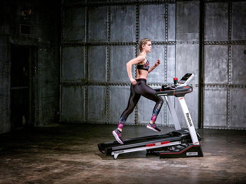 girl running on jet 100 treadmill