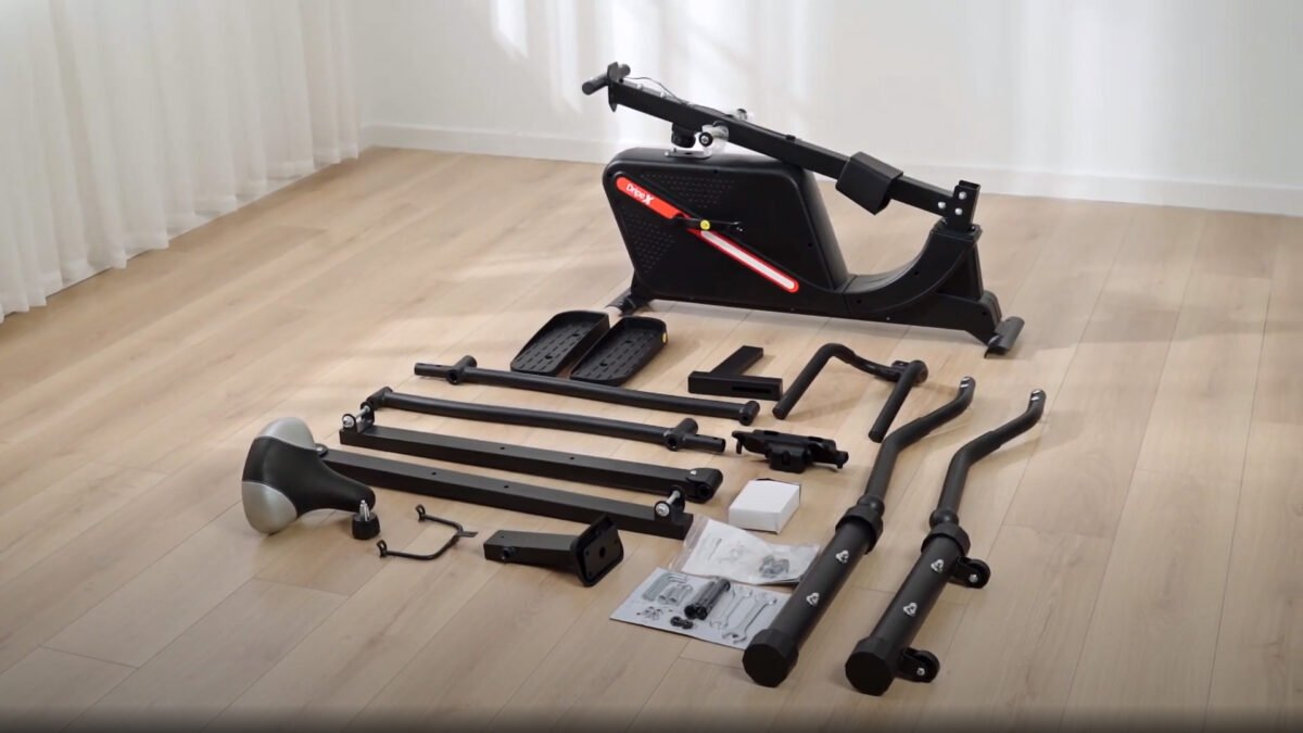 Dripex Cross Trainer parts for building parts laid out on floor