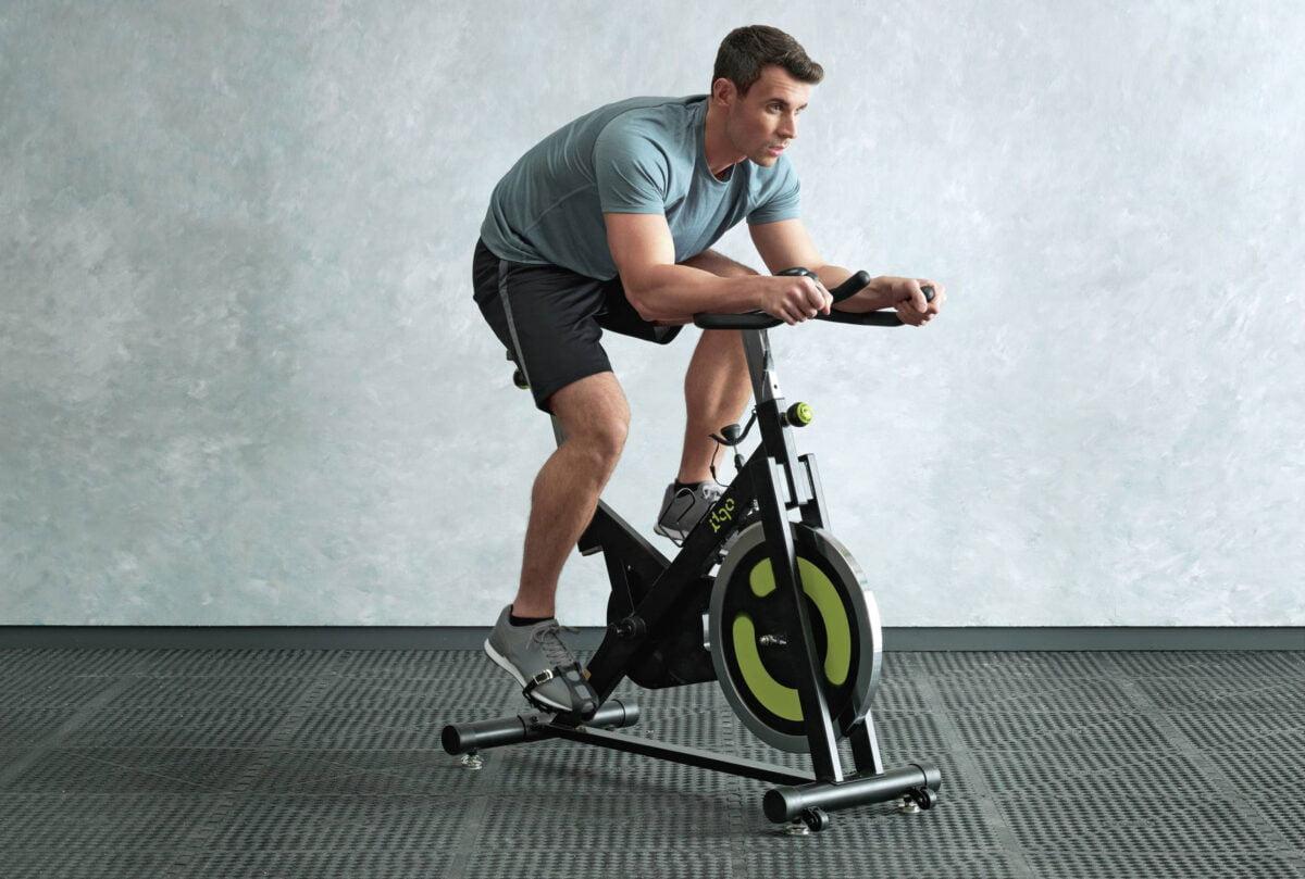 Man riding Opti Aerobic Manual Exercise Bike