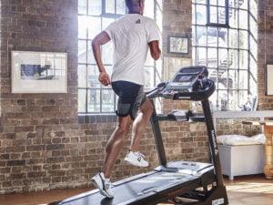 MAn running on Reebok ZJET 460 Bluetooth treadmill