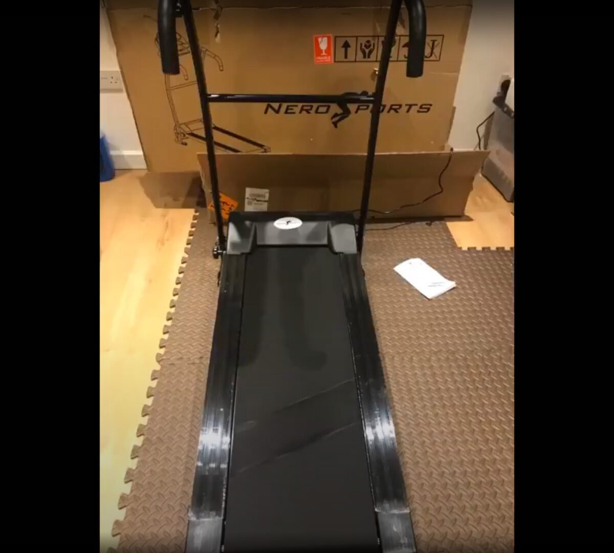 Nero Sports Motorized Treadmill in home gym with floor mats