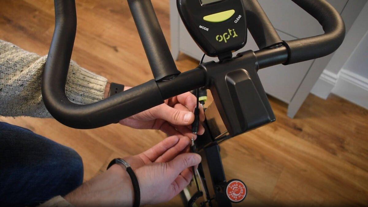 Opti Aerobic Manual Exercise Bike fixing the handle bars and LCD screen