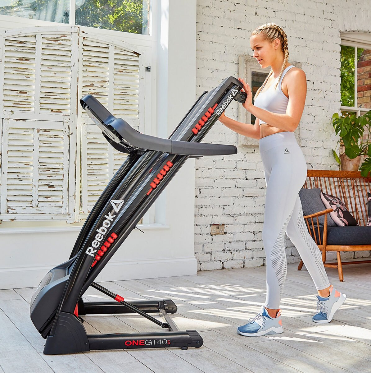 Reebok GT40s Touch Screen Treadmill folded away for storage