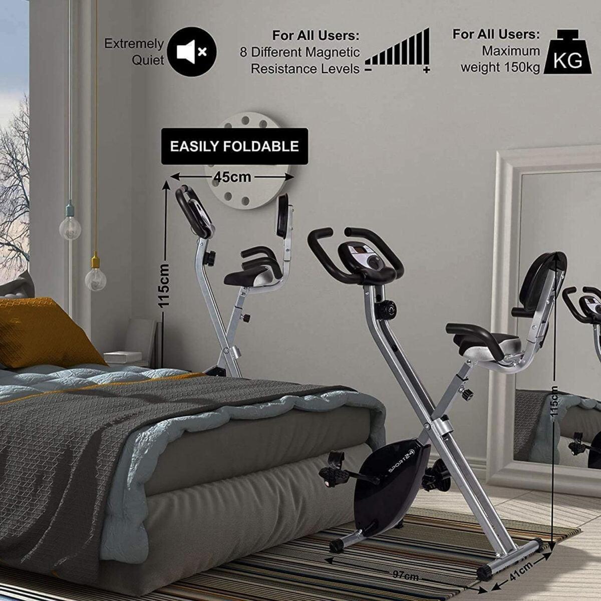 SPORT24 Folding Upright Exercise Bike in bedroom