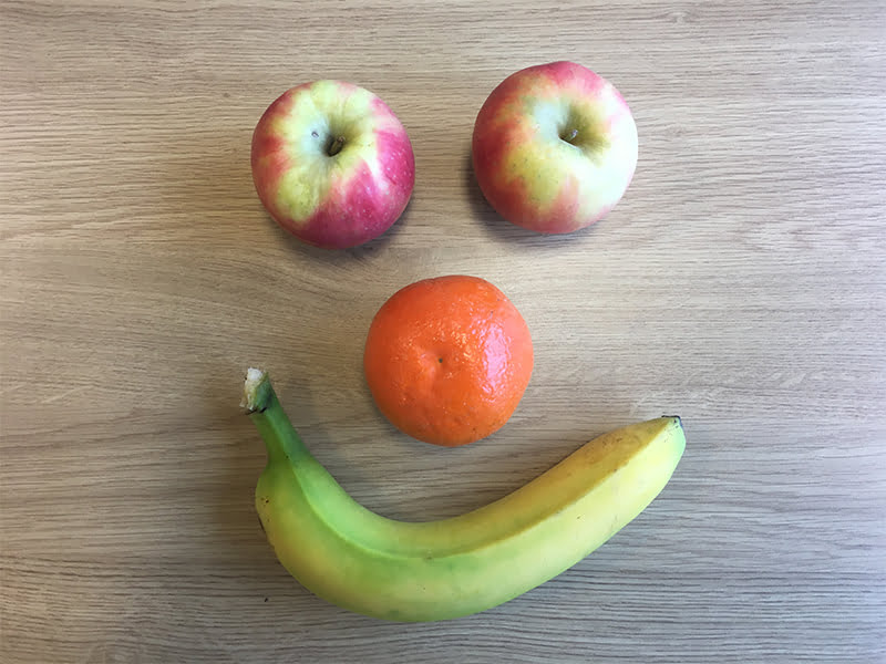 happy smiley face made out of apples oranges and bananas