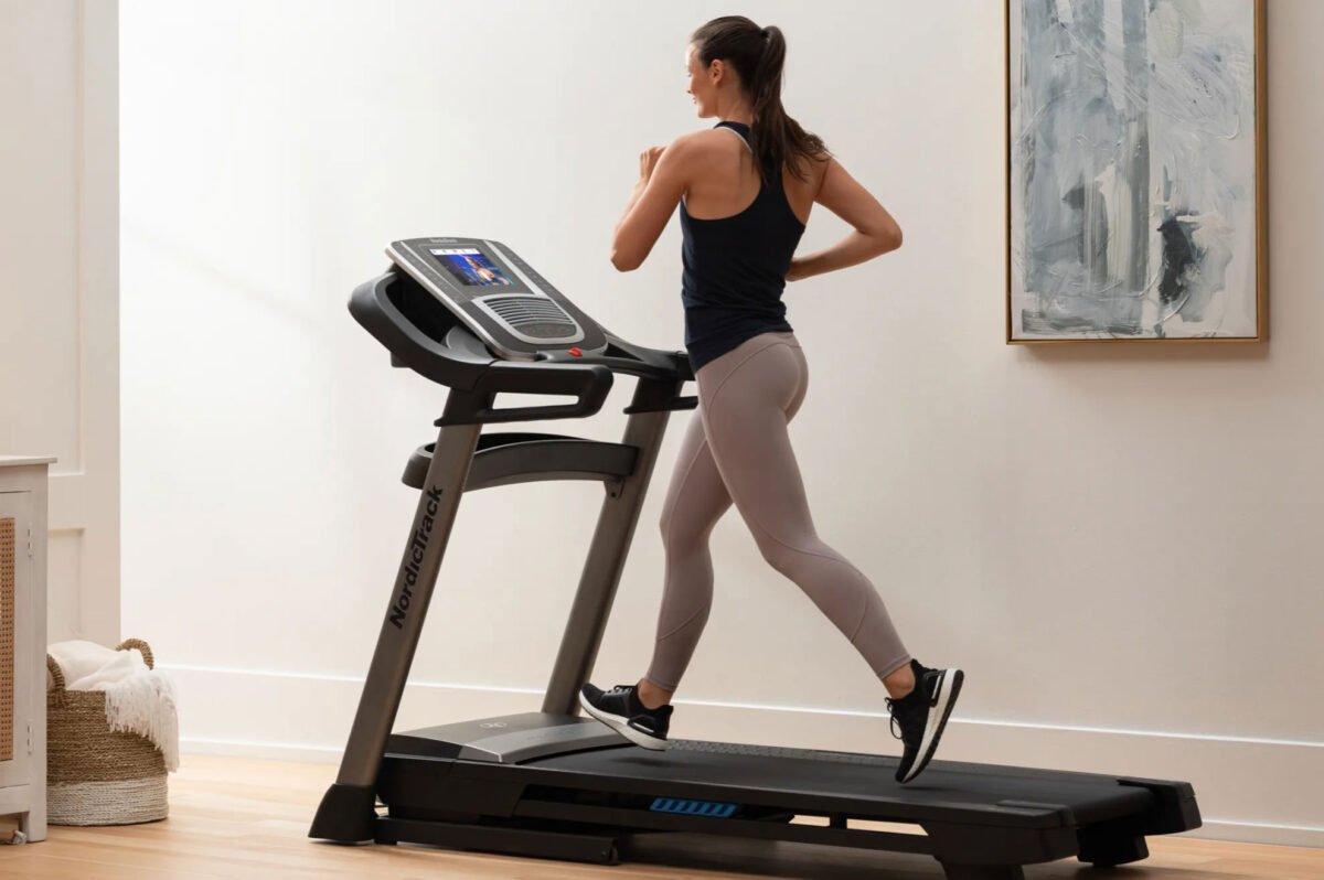 Women running NordicTrack S 45i Treadmill