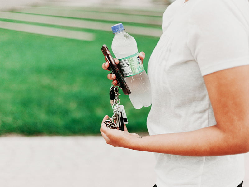 Girl with water bottle and car keys