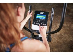 Girl using jet 100 cross trainer lcd display