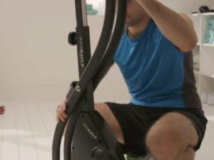 Man using Roger Black folding bike for the first time