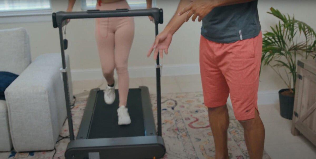 women running on Dynamax Folding Treadmill